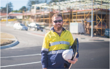 Construction contractors standing in front of the building Sydney | Contracts Specialist