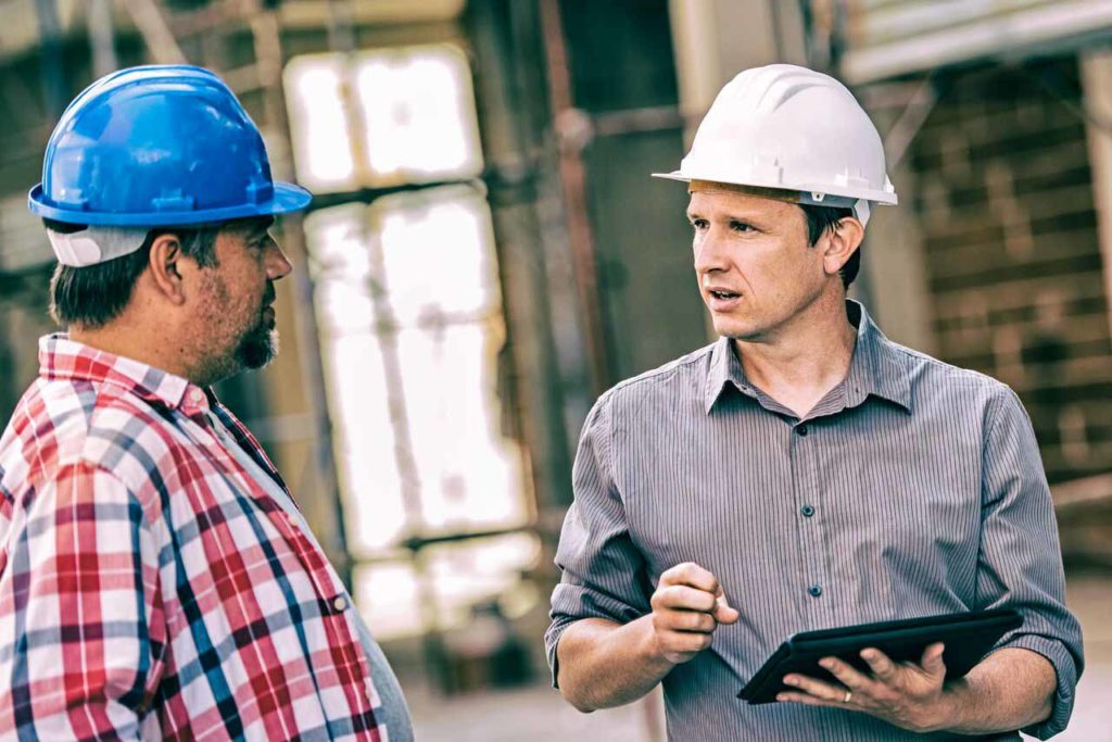 Builders discussing over a contract | Contracts Specialist