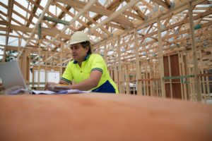 Builder at a construction site photo – Reference Date   Contracts Specialist