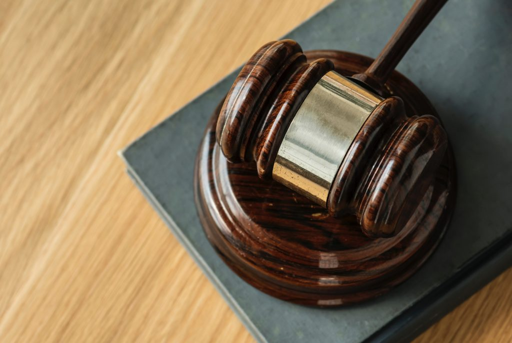 A Gavel placed in a courtroom table | Contracts Specialist