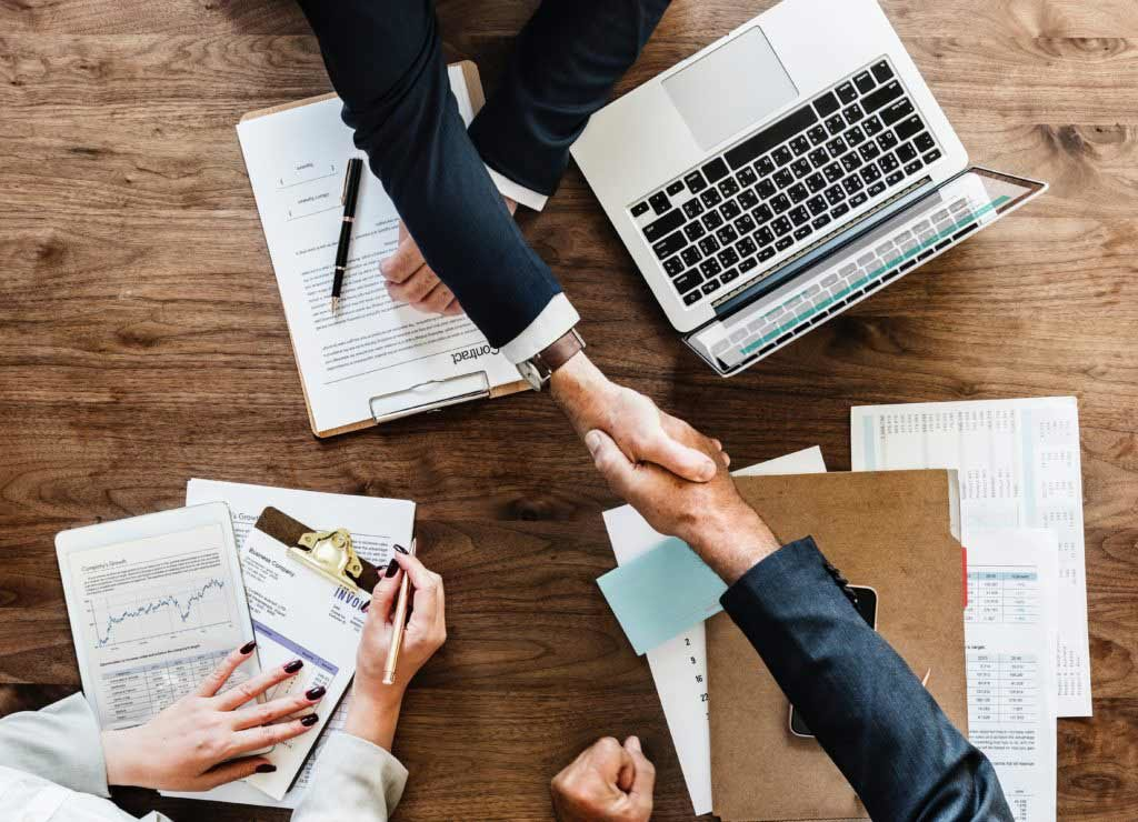 Contractor and Client Handshaking as a Sign of Agreement - Contract Signing   Contracts Specialist