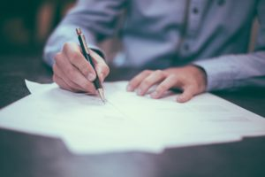A Homeowner signing a Construction Contract | Contracts Specialist